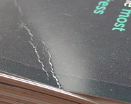 Close-up of dented cover